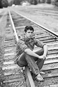 On the railroad tracks would be cool