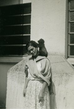 Frida Kahlo with a monkey, possibly her pet Fulang Chang