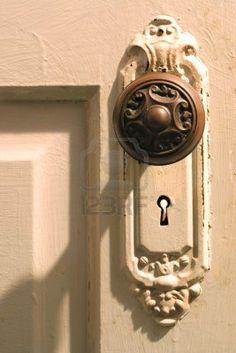 a antique door knob on a panel door