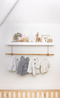 Hack of a standard white floating shelf to add a clothes rail for the new nursery.