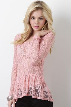 I love this top! The pink and the lace pattern are very pretty, and the long sleeves and length give it elegance too.