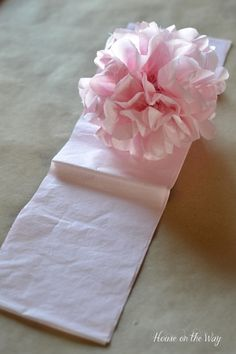 Different sized tissue paper and the amount of sheets used will determine different sized pom-poms.
