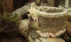 Wonderful handmade cuff with burlap and lace.  Seen in Altered Alchemy: romance