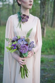 Purple orchid bouquet | Bit of Ivory Photography & Palette of Petals | see more on: http://burnettsboards.com/2014/05/disneys-maleficent-inspired-wedding/