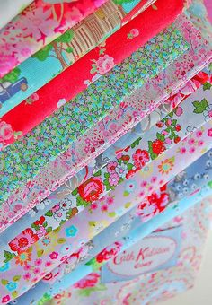 I would love to have these fabrics together in a scrap quilt. The combination of pinks and blues makes me happy!