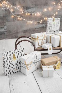 Verpacken leicht gemacht mit unseren Geschenktüten aus Papier, mit Druck in Schwarz und Gold.