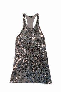 """Tunique argent, Mango - tendances mode printemps 2007 - Constellée d'éclats """"miroirs"""", voici une tunique que vous prendrez plaisir à porter sur un pantalon moulant. Le soir, rien ne vous empêche de la porter jambes nues, avec des talons..."""