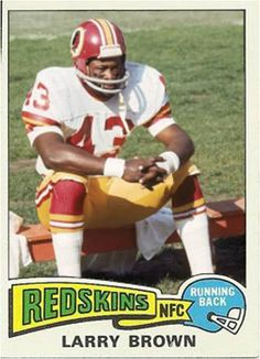 Running back Larry Brown of the Washington Redskins sits on the bench against the Cleveland Browns on October 26 1975 at Cleveland Municipal Stadium. Redskins Players, Redskins Fans, Redskins Football, Nfl Football Players, Football Cards, Football Helmets, Baseball Cards, Washington Redskins, Redskins Pictures