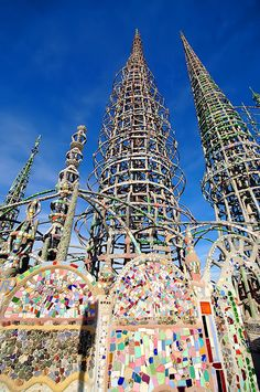 Watts Towers - Los Angeles; decorated with found objects, including bed frames, bottles, ceramic tiles, scrap metal and sea shells