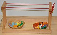 This clothesline activity helps children at Metropolitan Montessori School develop their pincer grip.