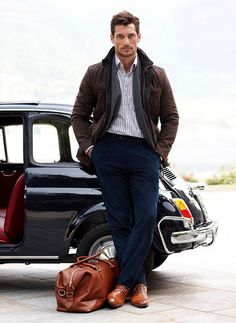 brown quilted jacket, striped shirt and navy cords.