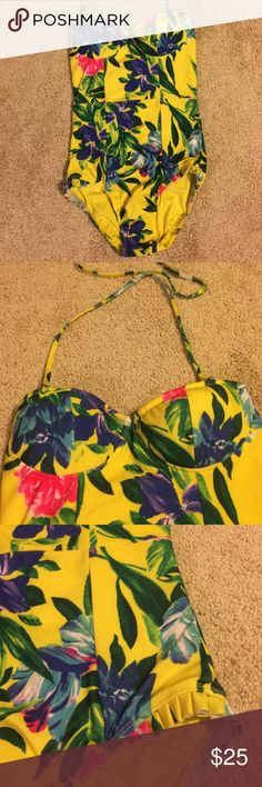 Bright Floral One-Piece Vintage-style one-piece swim suit. Has padded cups, flattering seaming down the front, and a cute ruffle detail on the hips. Excellent condition, worn maybe twice. Brand is Motel, purchased from ModCloth. ModCloth Swim One Pieces