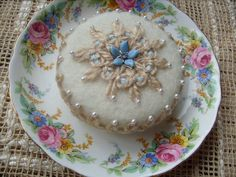 Cake Pincushion Off-White and Blue with Vintage China Saucer Pinkeep Cottage Chic by stbthreadworks on Etsy https://www.etsy.com/listing/101077647/cake-pincushion-off-white-and-blue-with
