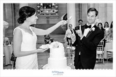 Bride and Groom cutting the cake during wedding reception in Cleveland