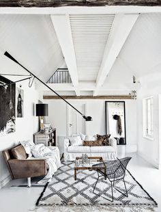 Moroccan Rug black and White living room with wood accents