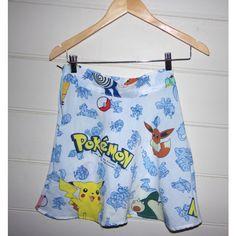 90s Pokemon Skater Skirt ($37) ❤ liked on Polyvore featuring skirts, mini skirts, black, women's clothing, women skirts, flared mini skirt, short black skirt, black circle skirt and black skirt