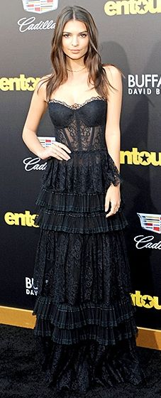 Emily Ratajkowski flashed her pearly whites while working a one-shoulder minidress, complete with a fringed skirt. Ankle booties completed the ensemble.