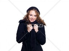attractive young female in winter clothes smiling. - Attractive young female in winter clothes smiling against while background, Model: Brittany Beaudoin