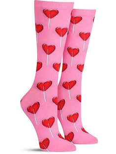 Oh, these are just too sweet! These fun heart candy socks feature lollipops in a romantic shape, perfect for Valentine's Day or as a gift for that certain special lady in your life! Some people make us feel like a sucker — in the best possible way, of course! Let these socks help you wear your heart on your sleeve ... or your feet!   Crew length Fits women's shoe size 5-10 Contents: 47% Cotton, 31% Polyester, 20% Nylon, 2% Spandex  by Hot Sox