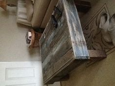 Pallet Coffee table with fence post legs- love it