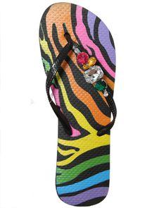 Rainbow zebra print flip flops with stones.