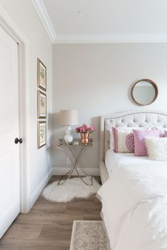 White and Pink Bedroom Inspiration | White Walls | White Bedding | Pink Accent Pillows | Hardwood Floors