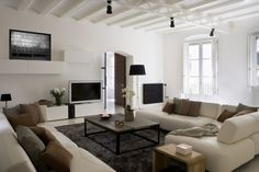 White Apartment #LivingRoom #Decor Ideas with White Sofa Brown Cushions Gray  Visit http://www.suomenlvis.fi/
