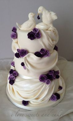 Beautiful drapes, doves and roses wedding cake