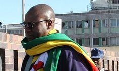 #ThisFlag movement leader Evan Mawarire, a 39-year-old pastor, arrives at a police station Harare on Tuesday.