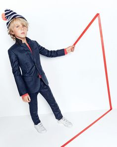 J.Crew boys' Ludlow suit jacket, slim Ludlow suit pant, long-sleeve pocket T-shirt, classic striped beanie with pom-pom and Adidas® Stan Smith™ sneakers.