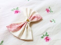 Floral Cream Bow with Pink Lace Available in Large ($10)