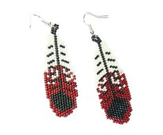 Red white and black beaded feather earrings.   via Etsy.