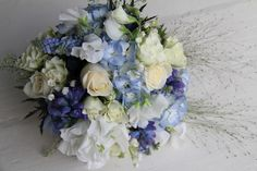 Pale Blue Hydrangeas, Lily of the Valley, Blue Muscari, Blue Bells, Blue Hyacinths, Sweet Peas, Cream Vendella Roses, Snowflake Floribunda Roses, Pastel shaded Anemones, Eryngium, Champagne Grass Panicum & Thalaspi.