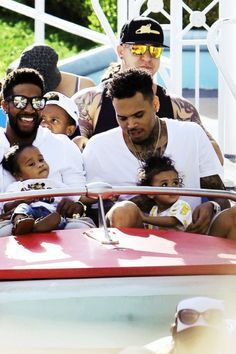 singers Omarion and Chris with their daughters. how cute?