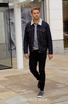 Men's street style | Denim Jacket Dreams - A denim jacket is a staple that every man should have in their wardrobe. Wear it with black skinnies and a classic pair of plimsolls for a slick look. | Shop the look at The Idle Man