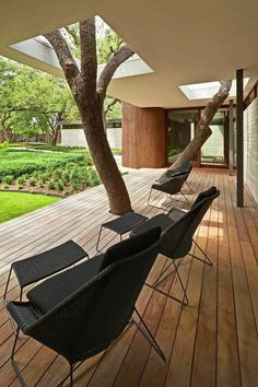 The clients insisted that none of the trees on the property be disturbed, so Kevin Alter and his team at Alterstudio Architecture built a deck and an overhang around two of them.