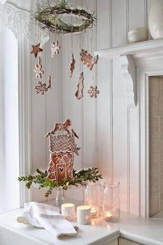 Swedish Farmhouse Christmas Decorating Interior Design white kitchen gingerbread house mobile cookies