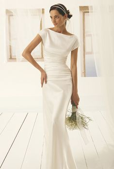 Brides: Le Spose Di Gi�. Satin bateau neckline, low waisted, ruched top on a mermaid skirt.