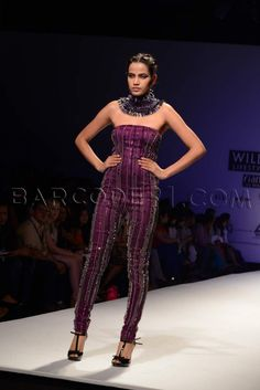 Purple jumpsuit.
