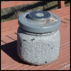 A simple textured spray paint transforms this jar. Hide it among granite rocks or concrete and it could be hard to spot.