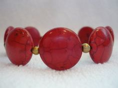 Bracelet of large red beads with dusty gold accents, $20.00