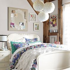 Love this bedroom. Great idea for a pin- up board over bed. Easy to make and paint a stencil in shape of a mirror.