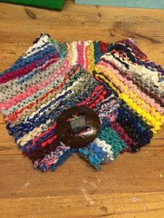 Scraps of yarn crocheted in a long chain then knitted in garter stitch to make a fun collar