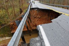 Louisville, Kentucky, Metro Police block Highway 22 after the road collapsed following heavy rains on April 3. John Sommers II/Reuters