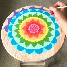 + Ideas for Cheap and Easy DIY Room Decor almost finished flower mandala painting, in rainbow colors, diy room decor, with many details, hand adding blue paint with a brush Whimsical Painted Furniture, Hand Painted Furniture, Funky Furniture, Paint Furniture, Plywood Furniture, Hand Painted Stools, Wooden Stools, Dot Art Painting, Mandala Painting