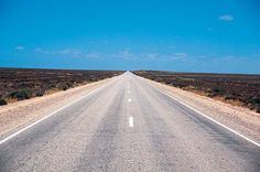 The world's longest, straightest part of a road is the 90 Mile Straght (146.6km) - a section of the Eyre Highway which runs across the Nullabor Plain, from Western Australia and into South Australia.   Crossing the Nullabor at (silly) speed will take 24 hours. But its better to take 4 days or more to explore the many country towns, see the Great Australian Bight, the desert, the roadhouses and TRY to spot a tree as you drive along the highway(Nullabor = treeless). Fascinating.