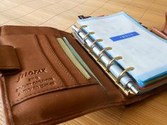 Filofax Siena, the gold rings and tan leather go so beautifully! Can't get over the pocket on the front though...