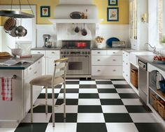 Vinyl tile flooring is now more stylish than ever. Vinyl tile is still available in a variety of patterns and colours to match your décor. Vinyl flooring tiles are durable, stylish and low-maintenance. White Kitchen Floor, Kitchen Tiles, Kitchen Flooring, New Kitchen, Kitchen Decor, Kitchen Yellow, Kitchen Black, Kitchen Vinyl, Flooring Store