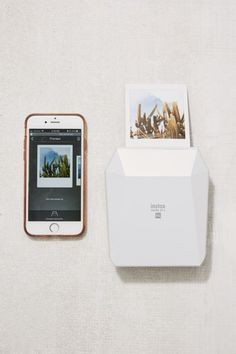 Shop Fujifilm Instax Share White Smartphone Instant Printer at Urban Outfitters today. Instax Printer, Polaroid Printer, Smartphone Printer, Iphone Printer, Portable Printer, Wireless Printer, New Polaroid Camera, Instax Mini Camera, Fujifilm Instax Mini