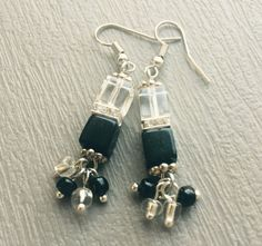 A personal favorite from my Etsy shop https://www.etsy.com/listing/257365938/earrings-black-white-cube-earrings-cube
